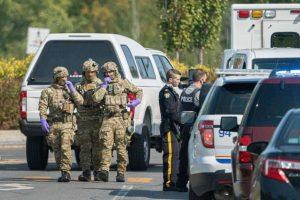 Police take part in an operation on Vauquelin Street in Saint-Hubert, Quebec-Milenio Stadium-Canada