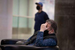 A passenger sits in a quiet Pearson airport in Toronto-Milenio Stadium-Canada