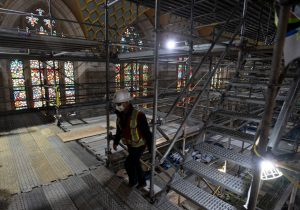 A worker climbs scaffolding in the chamber of the House of Commons -Milenio Stadium-Canada