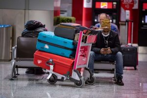 Passengers wait to board flights at Pearson International Airport in Toronto-Milenio Stadium-Canada