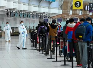 People line up and check in for an international flight at Pearson International airport-Milenio Stadium-Canada