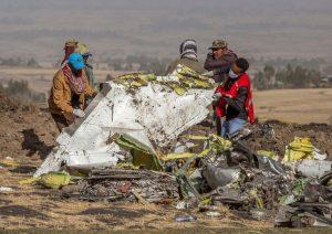 Rescuers work at the scene of the Ethiopian Airlines plane crash south of Ethiopia-Milenio Stadium-Canada