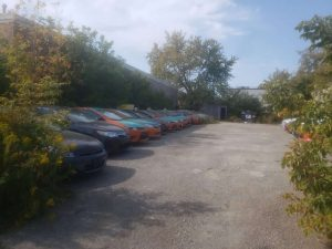 Several taxis are parked in a lot in September-Milenio Stadium-Ontario