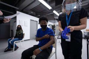 Black Creek Community Health volunteer gets his vaccine-Milenio Stadium-Canada