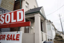 A Sold sign is displayed on a Toronto-area home that sold in March. Canadian home sales and prices soared to record highs that month, but have slowly fallen every month since. (Cole Burston/Bloomberg)